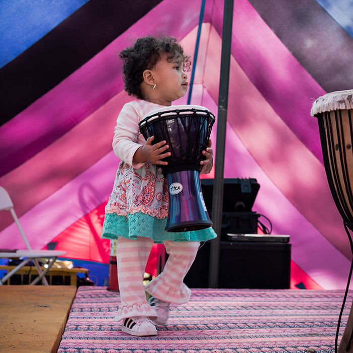 Photo of toddler with drum